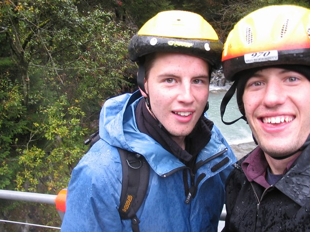 Switzerland: Us soaked with mudd in our faces trying to get a view of the river in the background