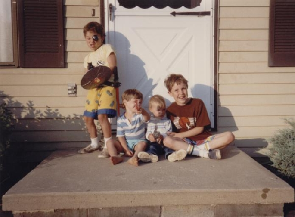 Drew and Little Sean and me with my weapons