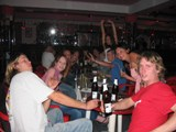 Greece: The table of random people on Matts b-day... the two guys in front had a disgusting threesome with the town whore that night